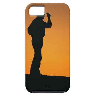 Photo, silhouette of a cowboy with his hand on iPhone 5 covers