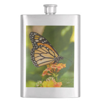 photograph of a butterfly on a flower hip flask