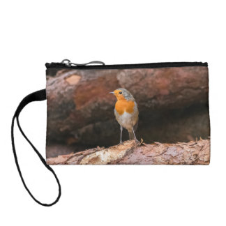 Photograph of a robin sitting on logs coin purse