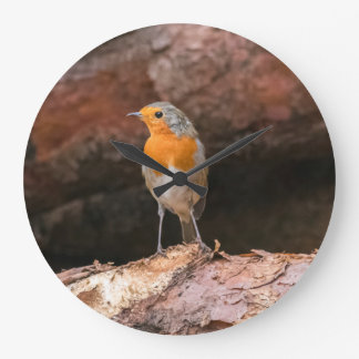 Photograph of a robin sitting on logs large clock
