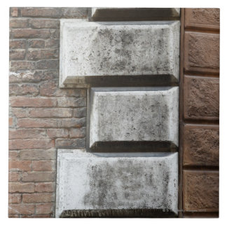 Photograph of an old brick wall in Siena Italy. Large Square Tile