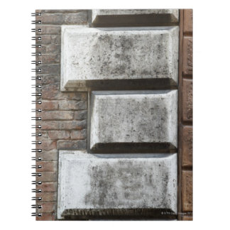 Photograph of an old brick wall in Siena Italy. Notebook