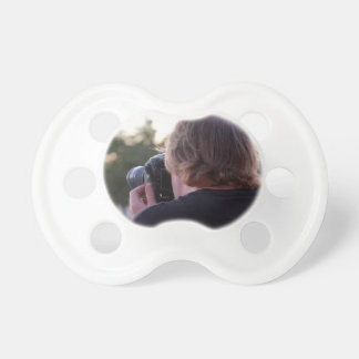 photographer taking picture male back of head pacifiers