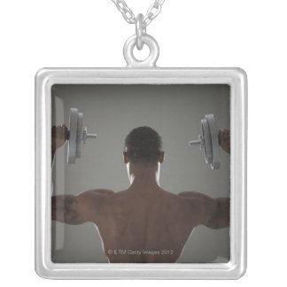 Physically fit man lifting dumbbells 2 square pendant necklace