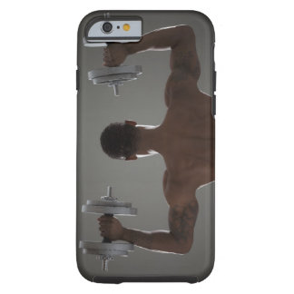 Physically fit man lifting dumbbells 2 tough iPhone 6 case