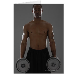 Physically fit man lifting dumbbells card