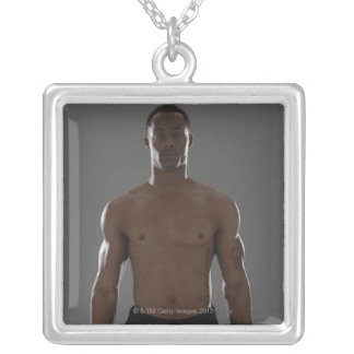 Physically fit man lifting dumbbells square pendant necklace
