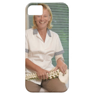 Physiotherapist with model of spine iPhone 5 covers