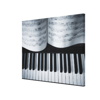 Piano Keys and Music Book Stretched Canvas Print