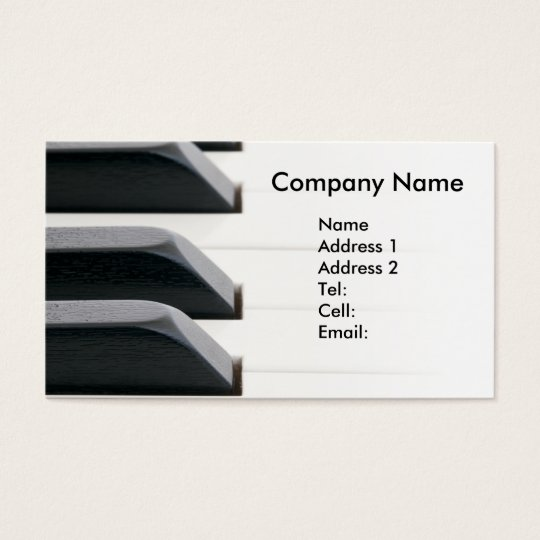 Piano keys fading to bright white business card
