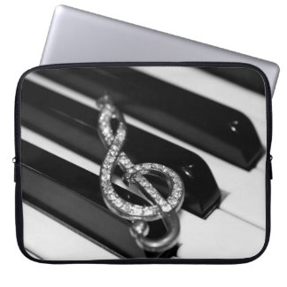 Piano with g-clef laptop sleeve
