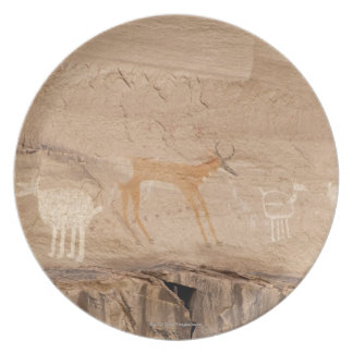 Pictographs of antelope, sheep and goats on plate