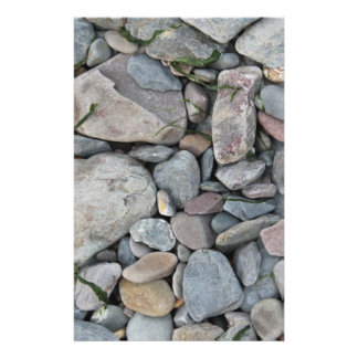 Picture of stones on a beach. 14 cm x 21.5 cm flyer