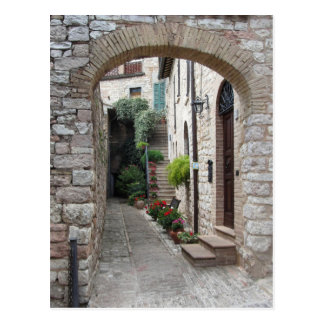 Picturesque old village with flowers postcard