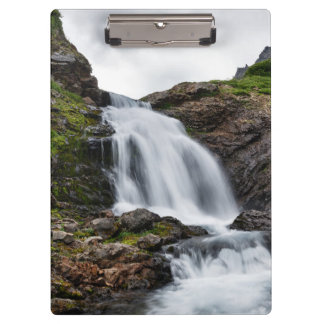 Picturesque waterfall in mountain range clipboard