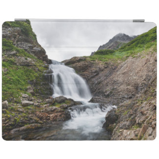 Picturesque waterfall in mountain range iPad cover