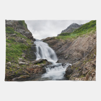 Picturesque waterfall in mountain range towel