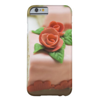 Piece of birthday cake with marzipan roses on barely there iPhone 6 case