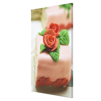 Piece of birthday cake with marzipan roses on canvas print