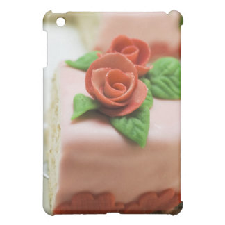 Piece of birthday cake with marzipan roses on case for the iPad mini