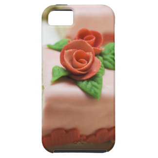 Piece of birthday cake with marzipan roses on iPhone 5 cover
