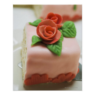 Piece of birthday cake with marzipan roses on poster