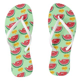 Piece of watermelon expressing pain after a bite flip flops