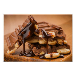 Pieces of chocolate with almonds and caramel encim poster