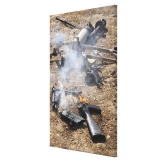 Pieces of enemy weapons lay out to cool off canvas print