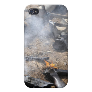Pieces of enemy weapons lay out to cool off cover for iPhone 4