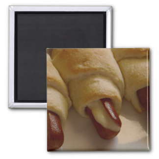 Pigs in a blanket with cheese magnet