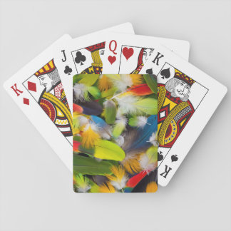 Pile of colorful feathers playing cards