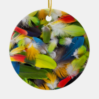 Pile of colorful feathers round ceramic decoration