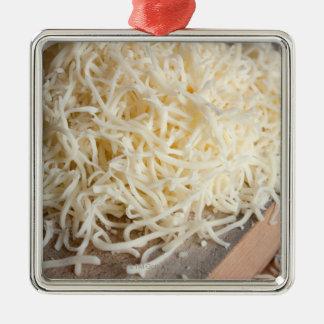 Pile of fresh mozzarella cheese. Silver-Colored square decoration