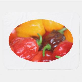 pile of habanero hot peppers receiving blanket