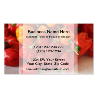 pile of habanero hot peppers top pack of standard business cards