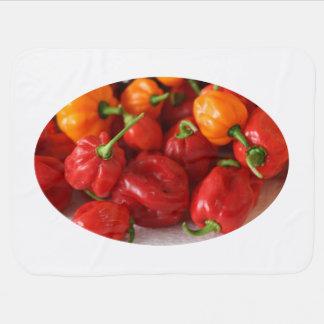 pile of habanero hot peppers top receiving blanket