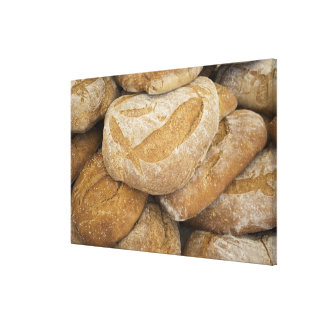 Pile of large bread loaves canvas print