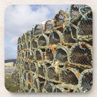 pile of lobster crab pots on Irish shoreline Coaster
