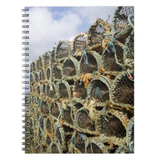 pile of lobster crab pots on Irish shoreline Notebook