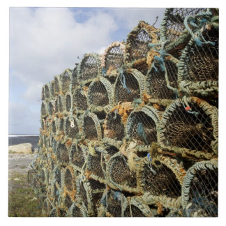 pile of lobster crab pots on Irish shoreline Tiles