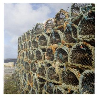 pile of lobster crab pots on Irish shoreline Large Square Tile