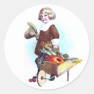Pilgrim Boy and Wheelbarrow of Fruits & Veggies Round Sticker