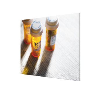 Pill bottles on stock page canvas print