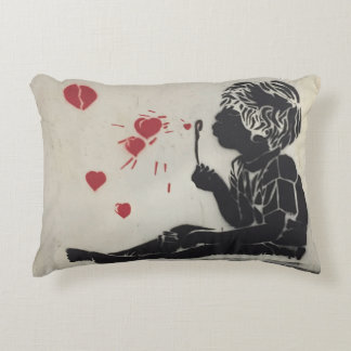 Pillow with a boy blowing red heart bubbles