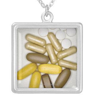 Pills on paper square pendant necklace