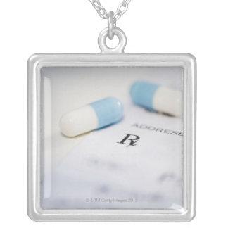 Pills on written prescription silver plated necklace