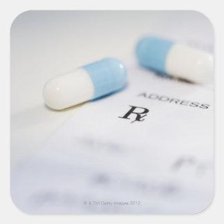 Pills on written prescription square sticker