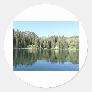 pine tree mirror on lake classic round sticker