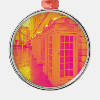 Pink and yellow telephone boxes Silver-Colored round decoration